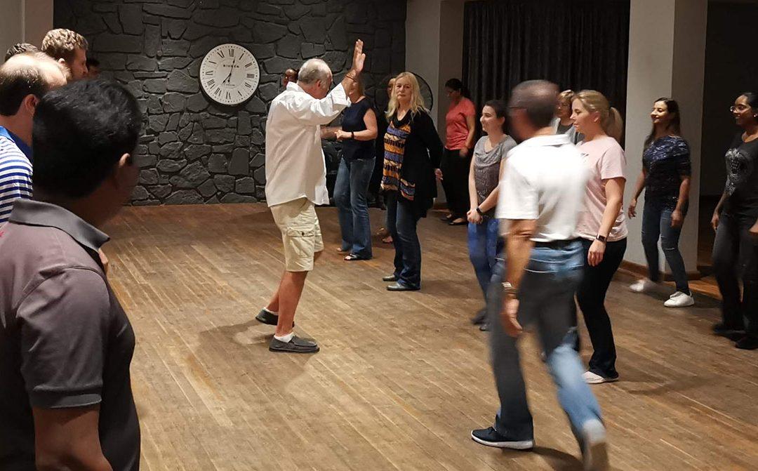 Jose teaching a group dance class